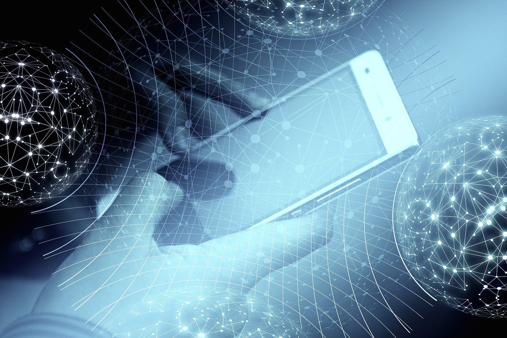 Anaxco Blog Beitrag Bild Hand hält Handy IT-Services IT-Dienstleister IT-Lösungen Cybersecurity Digitalisierung